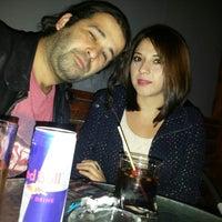 Photo taken at Pub Deluxe by Eduardo M. on 4/5/2014
