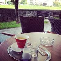 Photo taken at Café Spago by Ari J. on 10/6/2014