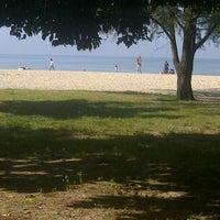 Photo taken at Pantai Saujana (Pantai Batu Empat) by Amar Z. on 1/6/2013