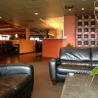 Photo taken at Suite 100 Restaurant, Bar & Lounge by Richard M. on 9/22/2013