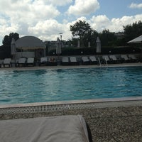 Photo taken at Conrad Pool by Bennur D. on 7/16/2013