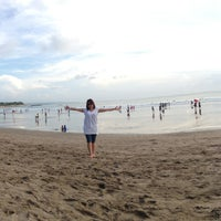 Photo taken at Kuta Beach by Conny I. on 6/10/2013
