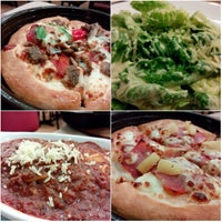 Photo taken at Pizza Hut by Tam O. on 9/20/2014