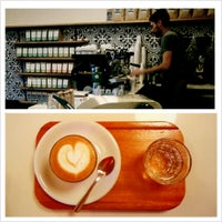 Photo taken at Olympia Coffee Roasting Co. by D. N. on 4/5/2013