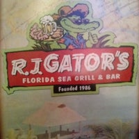 Photo taken at R.J. Gator's by Lauren A. on 12/20/2013