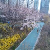 Photo taken at Yangjaechun Trails by Young-Won K. on 4/10/2013