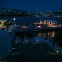 Photo taken at moon beach clup by Yuksel Y. on 5/22/2014