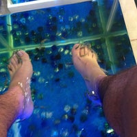 Photo taken at Fish Spa Therapy by Abraham C. on 3/18/2014