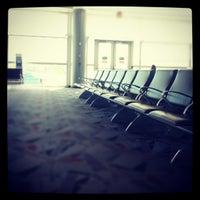 Photo taken at Gate D19 by Kris A. on 10/29/2012