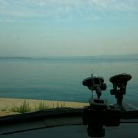 Photo taken at Palmiye Beach by Serkan S. on 6/14/2014