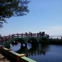 Photo taken at Pantai Pasir Kencana by Efi R. on 8/15/2013