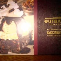 Photo taken at Outback Steakhouse by Bayan Y. on 8/30/2013