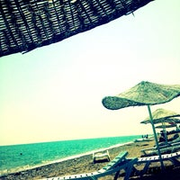 Photo taken at Ünlüselek Beach by Esin Zekoş E. on 8/29/2013