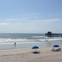 Photo taken at Cocoa Beach Pier by John T. on 4/10/2013