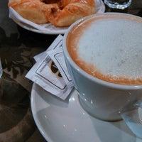 Photo taken at laCrème Restaurant by Santiago A. on 5/8/2014