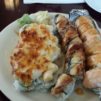Photo taken at Minato Sushi Cafe by Allie D. on 1/2/2015