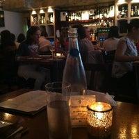 Photo taken at The Tangled Vine Wine Bar & Kitchen by Cheyenne M. on 6/18/2013