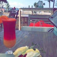 Photo taken at Surfers Beach Cafe Pizerria and Bar by Mohammed a. on 8/19/2016