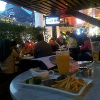 Photo taken at Artiste Cafe & Lounge by Adhimulya N E. on 11/28/2015