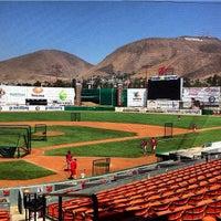 Photo taken at Estadio Gasmart by Toros de Tijuana on 7/12/2013