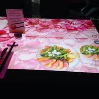 Photo taken at Oshi Asian Interactive restaurant by Tatiana K. on 5/1/2015