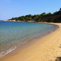 Photo taken at Mandraki beach by Filippo D. on 8/24/2013