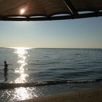 Photo taken at Amara Marine Nature Beach by Екатерина Р. on 8/8/2013