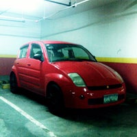 Photo taken at The Podium Basement Parking by CarloMiguel M. on 7/25/2013