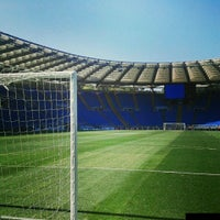 Photo taken at Stadio Olimpico by Matteo O. on 4/15/2013