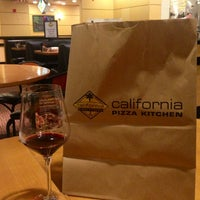 Photo taken at California Pizza Kitchen by Kira R. on 6/29/2013