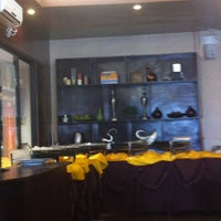 Photo taken at Backyard Grille Restaurant and Cafè by DocRonIsHere on 1/25/2013