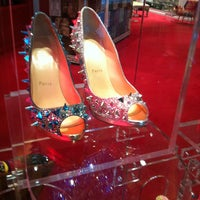 Photo taken at Christian Louboutin by Yazmin on 3/29/2013