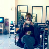 Photo taken at Looks & Faces Salon & Spa by judz h. on 3/31/2013