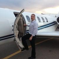 Photo taken at Rocky Mountain FBO by Bryan B. on 12/6/2012