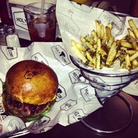 Photo taken at HolyCow Burger & Beer  Joint by Flor G. on 4/9/2013