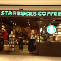 Photo taken at Starbucks by Letícia T. on 4/18/2013