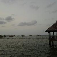 Photo taken at Dampo Awang Beach by Lathifah H. on 5/17/2013