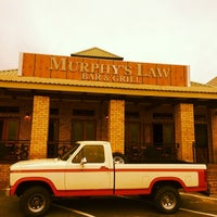 Photo taken at Murphy's Law Bar & Grill by Tyronne S. on 3/17/2014