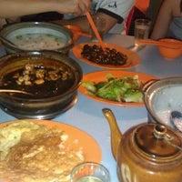 Photo taken at Win Yin Porridge by Tammie T. on 10/15/2011