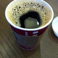 Photo taken at Starbucks by philomenus k. on 12/20/2012