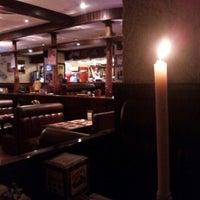 Photo taken at American Bar & Grill by Святослав Ч. on 4/28/2013