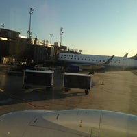Photo taken at Gate C105 by Timothy R. on 8/6/2013