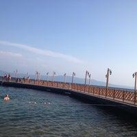 Photo taken at Narlı Beach Club by Serpil I. on 8/11/2013