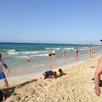 Photo taken at Spiaggia San Vito Lo Capo by Olga B. on 6/23/2013