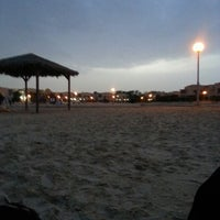 Photo taken at Al Nakheel Beach by Dalal A. on 4/25/2013