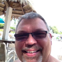 Photo taken at The Oasis Pool Bar by Karl K. on 8/17/2013