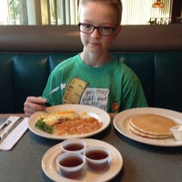 Photo taken at Ridgway's Restaurant & Lounge by Jeni M. on 4/17/2014
