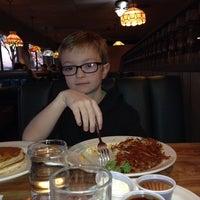 Photo taken at Ridgway's Restaurant & Lounge by Jeni M. on 1/17/2014
