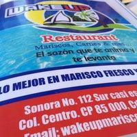 Photo taken at Wake up mariscos by Eduardo A. on 12/31/2013