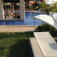 Photo taken at Romanos Costa Navarino Pool by Coletsos J. on 7/30/2013